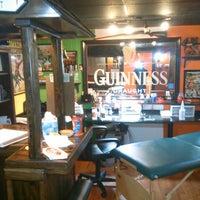 Photo taken at Upstate Tattoo Co. by Jon K. on 2/22/2014