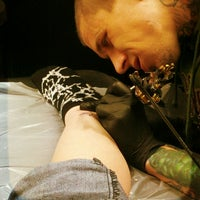 Photo taken at Ultimate Arts Tattoo by Amy T. on 4/24/2013