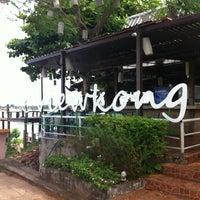 Photo taken at View Khong Restaurant by Manida B. on 11/17/2012