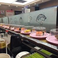 Photo taken at Sushi Express (争鲜回转寿司) by Nataliya G. on 4/16/2015