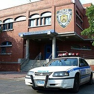Photo taken at NYPD - 107th Precinct by TS M. on 9/28/2013