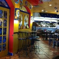 Photo taken at Tarantella Ristorante & Pizzeria by Rodrigo H. on 11/18/2012