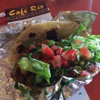 Photo taken at Cafe Rio Mexican Grill by Angel L. on 6/8/2014