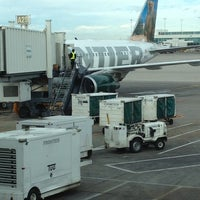 Photo taken at Gate A27 by Ronnie K. on 12/16/2012