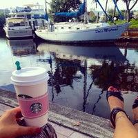 Photo taken at Marina Bay Marina by Alina N. on 6/30/2014