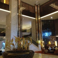 Photo taken at Hilton Zhongshan Downtown by sean w. on 1/14/2015