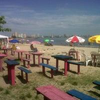 Photo taken at Praia Alegre by Dialison C. on 2/6/2013