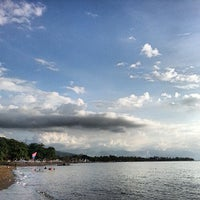 Photo taken at Pantai Lovina (Lovina Beach) by Sherwin T. on 5/6/2013