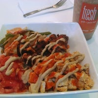 Photo taken at FreshU Grill and Juice Bar by Justin D. on 12/28/2013