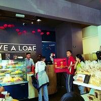 Photo taken at Love A Loaf Bakery & Café by Steven C. on 7/11/2014