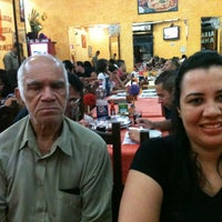 Photo taken at Pizzaria Rainha do Parque by Fabiana G. on 4/7/2013