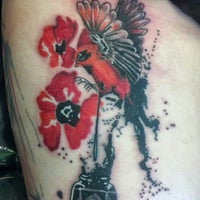 Photo taken at Mind Crusher Tattoo by Kevin O. on 6/30/2013