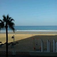 Photo taken at La Victoria Beach by Fernando C. on 10/12/2012