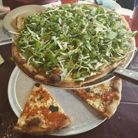 Photo taken at Reggiano's Brick Oven Pizza & Cafe by Desmond C. on 10/1/2016
