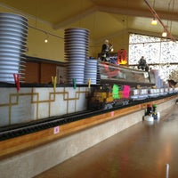 Photo taken at Sushi Train by Amy G. on 7/6/2013