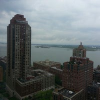 Photo taken at New York Marriott Downtown by Juan V. on 5/11/2013