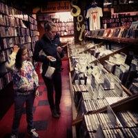 Photo taken at Music Millennium by Kristin B. on 4/7/2013