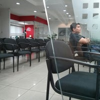 Photo taken at Banco de America Central (BAC) by Javier A. on 3/7/2013