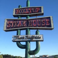 Photo taken at Hilltop Steakhouse by Andrew C. on 6/4/2013