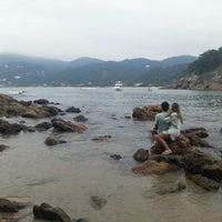Photo taken at Praia das Conchas by Aline C. on 2/10/2013
