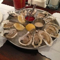 Photo taken at Docks Oyster Bar by Jonathan E. on 12/23/2012