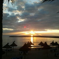 Photo taken at Las Vistas Beach by Wilma V. on 1/1/2013