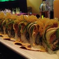 Photo taken at Yoki Japanese Restaurant and Sushi Bar by Justin K. on 4/30/2013
