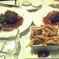 Photo taken at Noir Food & Wine by Jennifer N. on 9/15/2012