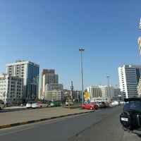 Photo taken at Sharjah Clock Tower by Helmie Z. on 12/29/2012