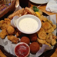 Photo taken at Floyds Cajun Seafood And Texas Steakhouse by Kim H. on 7/6/2013