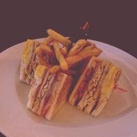 Photo taken at Cafe 21 by Flor J. on 5/30/2014