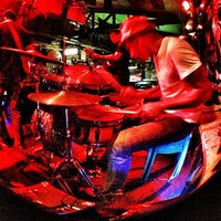 Photo taken at Handlebar Bar and Grill by Wowee P. on 10/12/2012