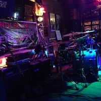 Photo taken at Handlebar Bar and Grill by Wowee P. on 9/6/2013