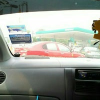 Photo taken at PETRONAS Station by Fina R. on 5/2/2016