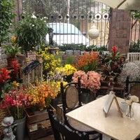 Photo taken at El Jardín Café by Rodrigo V. on 6/16/2014
