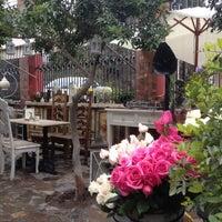 Photo taken at El Jardín Café by Rodrigo V. on 6/15/2014