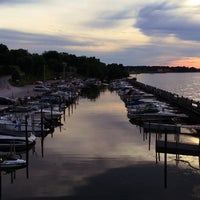 Photo taken at Sunset Harbor Bar & Grille by Adam K. on 7/5/2014