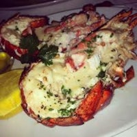 Photo taken at Eddie V's Prime Seafood by Mark Q. on 12/23/2012