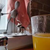 Photo taken at Cateye Cafe by Jason K. on 10/1/2014