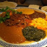 Photo taken at Axum Cafe by Lana C. on 10/7/2012