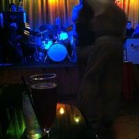 Photo taken at Hip Kitty Jazz & Fondue by Erika R. on 10/13/2012