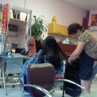Photo taken at Mystic Hair Salon by Rebull J. on 7/27/2013