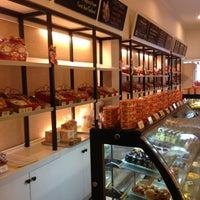 Photo taken at DE CAFÉ Resto & Delicatessen by Poppy S. on 2/10/2013