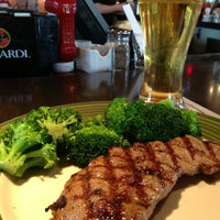 Photo taken at Applebee's Neighborhood Grill & Bar by Bryan H. on 4/6/2013