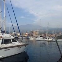 Photo taken at Porto dell'Etna - Marina di Riposto by Fusun B. on 9/4/2013