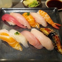 Photo taken at Mikuni by Adam M. on 4/9/2013