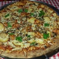 Photo taken at Gusto Ristorante&Pizza by Halil Volkan T. on 5/10/2016