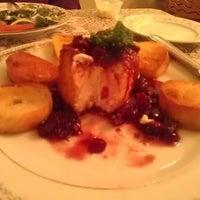 Photo taken at Purple Door Cafe & Konditorei by Sara H. on 12/22/2012
