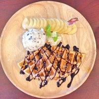 Photo taken at Iris Cafe by THICHA on 7/25/2015