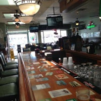 Photo taken at Irish Eyes Pub & Restaurant by Dan M. on 5/11/2013